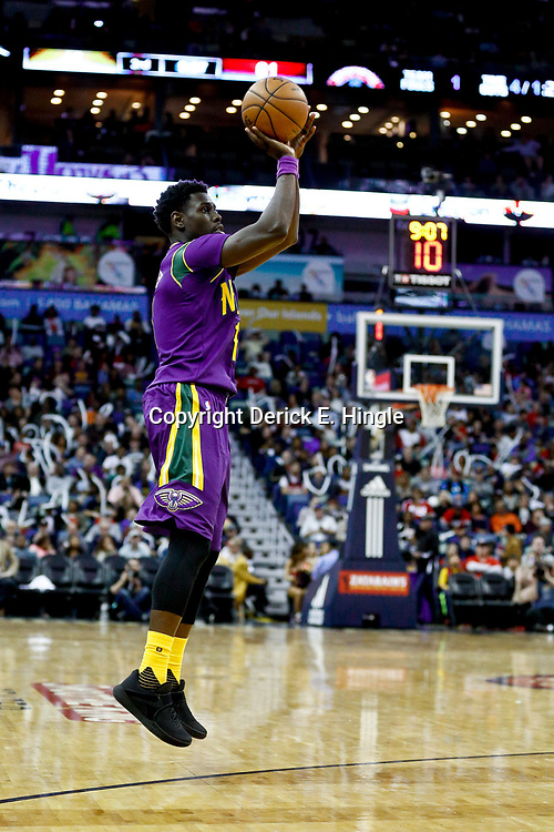 Jan 29, 2017; New Orleans, LA, USA; New Orleans Pelicans guard Jrue Holiday (11) shoots against the Washington Wizards during the second half of a game at the Smoothie King Center. The Wizards defeated the Pelicans 107-94. Mandatory Credit: Derick E. Hingle-USA TODAY Sports