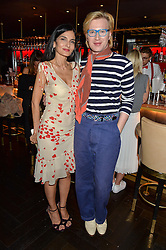 YASMIN MILLS and HENRY CONWAY at the launch of Giovanni's Gin Joint at Quaglino's, 16 Bury Street, London on 13th July 2016.