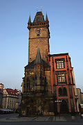 The Town Hall and Tower in Old Town Square, Prague, Czech Republic. The buildings were first build in 1338 and now consist of a row of colorful Gothic and Renaissance buildings.