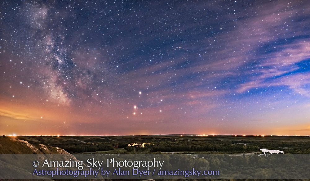The August 24, 2016 conjunction of Mars (in the middle) and Saturn (above Mars), with both planets above the star Antares in Scorpius, all low in the southwest over the Bow River, at Blackfoot Crossing, Alberta. The site is overlooking the Bow River valley and the traditional meeting place on the Bow for the Blackfoot Nation, and where Treaty Seven was signed in 1877. Today, just behind where I stood for this image is the impressive Blackfoot Crossing Historical Park and museum run by the Siksika Nation. <br /> <br /> The Milky Way is to the left and the last glow of sunset twilight to the right. Clouds added the natural glows around the planets and stars. Unfortunately, light pollution discolours the horizon. <br /> <br /> This is a panorama of two images, with the Nikon D750 and 24mm Sigma lens, for 20 seconds at f/2 and ISO 1600, taken prior to starting a time-lapse sequence. Stitched with Adobe Camera Raw.