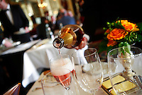pouring pink champagne at theThe Michelin three star Restaurant Grand Vefour in Plais Royale,..Paris