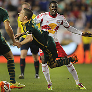 Lloyd Sam, New York Red Bulls, fouls Will Johnson, Portland Timbers, which resulted in a yellow card during the New York Red Bulls Vs Portland Timbers, Major League Soccer regular season match at Red Bull Arena, Harrison, New Jersey. USA. 24th May 2014. Photo Tim Clayton