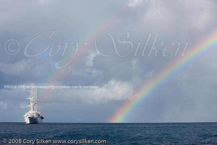 Cruise ship Club Med 2 at anchor, with a rainbow