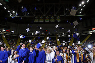 Students toss their caps during the 119th annual Springboro High School commencement at the Nutter Center in Fairborn, Saturday, June 2, 2012.