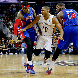 Dec 11, 2013; New Orleans, LA, USA; New Orleans Pelicans shooting guard Eric Gordon (10) collides with Detroit Pistons power forward Greg Monroe (10) and small forward Josh Smith (6) during the second quarter at New Orleans Arena. Mandatory Credit: Derick E. Hingle-USA TODAY Sports