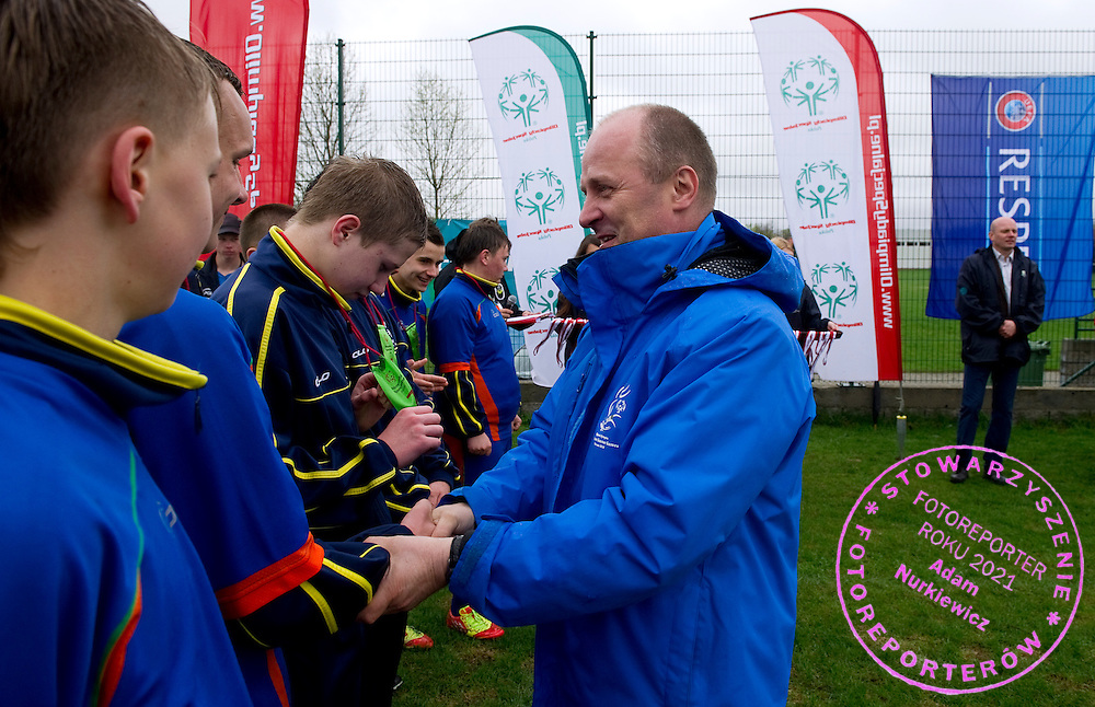 (R) Boguslaw Galazka - Director of Special Olympics Poland gives medals while medal's ceremony during Polish Soccer Tournament Unified of Special Olympics in Mietne on April 28, 2013.The idea of Special Olympics is that, with appropriate motivation and guidance, each person with intellectual disabilities can train, enjoy and benefit from participation in individual and team competitions...Poland, Mietne, April 28, 2013..Picture also available in RAW (NEF) or TIFF format on special request...For editorial use only. Any commercial or promotional use requires permission...Mandatory credit: Photo by © Adam Nurkiewicz / Mediasport