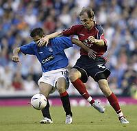 Photo Aidan Ellis.<br />Glasgow Rangers v CSKA Moscow.<br />Champions League Qualifing Rd 3 2nd leg.<br />25/08/2004.<br />Rangers Nacho Novo and Moscow's Elvir Rahmic