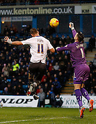 Gillingham FC goalkeeper Stuart Nelson manages to beat Bury FC Striker Tom Pope to the ball with his fist  during the Sky Bet League 1 match between Gillingham and Bury at the MEMS Priestfield Stadium, Gillingham, England on 14 November 2015. Photo by Andy Walter.