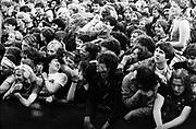 Music concert crowd scene up against barrier, UK, 1980's