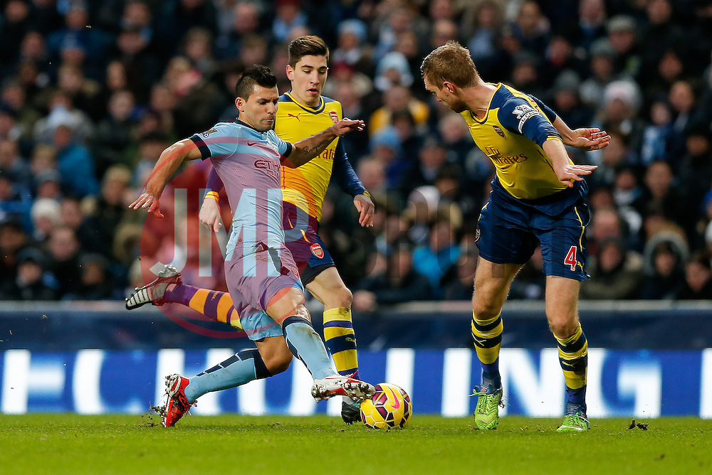 is challenged by is challenged by Hector Bellerín of Arsenal - Photo mandatory by-line: Rogan Thomson/JMP - 07966 386802 - 18/01/2015 - SPORT - FOOTBALL - Manchester, England - Etihad Stadium - Manchester City v Arsenal - Barclays Premier League.