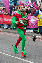 © Licensed to London News Pictures. 24/04/2016. London, UK. A fancy dress runner dressed as a pixie elf runs over Tower Bridge at the halfway point of the 2016 London Marathon.  Photo credit : Vickie Flores/LNP