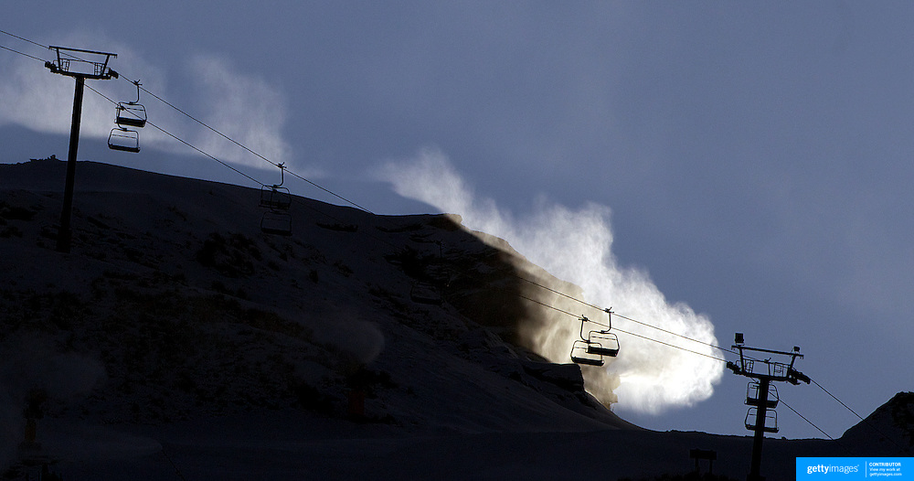 The snow making machines in operation at Coronet Peak ski field as temperatures finally drop to enable snow making. The  unusually warm weather has delayed the start of the ski season in New Zealand. Coronet Peak, Queenstown,  South Island, New Zealand, 28th June 2011