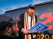 10 DECEMBER 2019 - DES MOINES, IOWA: ANDREW YANG signs a supporter's yard sign at the Iowa State Capitol before the start of Yang's bus tour. Yang, an entrepreneur, is running for the Democratic nomination for the US Presidency in 2020. He kicked off a five day bus tour today at the Iowa State Capitol in Des Moines. Iowa hosts the the first election event of the presidential election cycle. The Iowa Caucuses will be on Feb. 3, 2020.        PHOTO BY JACK KURTZ