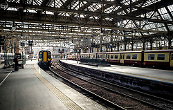 A local ScotRail commuter passenger train arriving at Central Station in Glasgow, Scotland<br /> <br /> (c) Andrew Wilson | Edinburgh Elite media