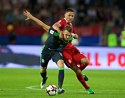 BELGRADE, SERBIA - Sunday, June 11, 2017: Wales' Aaron Ramsey and Serbia's Namanja Matic during the 2018 FIFA World Cup Qualifying Group D match between Wales and Serbia at the Red Star Stadium. (Pic by David Rawcliffe/Propaganda)