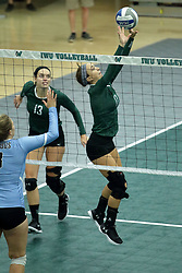 23 September 2017:  Rachel Burkman & Kira Jackson during an NCAA womens division 3 Volleyball match between the Tufts Jumbos and the Illinois Wesleyan Titans in Shirk Center, Bloomington IL