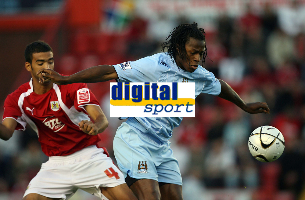 Photo: Rich Eaton.<br /> <br /> Bristol City v Manchester City. Carling Cup. 29/08/2007. Man City's goalscorer Emile Mpenza (r) shields the ball from Liam Fontaine (l).