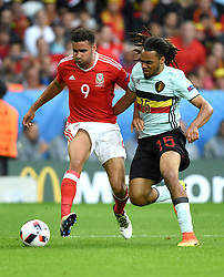 Hal Robson-Kanu of Wales battles for the ball with Jason Denayer of Belgium  - Mandatory by-line: Joe Meredith/JMP - 01/07/2016 - FOOTBALL - Stade Pierre Mauroy - Lille, France - Wales v Belgium - UEFA European Championship quarter final