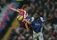 Photo: Lee Earle.<br /> Portsmouth v Sheffield United. The Barclays Premiership. 23/12/2006. United's Stephen Quinn (L) clashes with Glen Johnson.