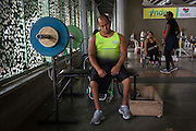 "2016/03/10 – Medellin, Colombia: Joe Gonzalez Bettencourt, 38, tries to relax after some weight lifting exercises in the gymnasium at Atanasio Girardot Stadium, Medellin, 10th March, 2016. <br /> -<br /> Joe was a teenager when a paramilitary group approached him and his friends to become part of the Bloque Cacique Nutibara gang by starting to steal and kill. Joe and his friends refused because they didn't like violence and were more interested in party and living a life like any other normal teenager. But that refuse came with a high price. Joe and his best friend were chased on motorbike and the gang shot them. Joe was hit twice, one bullet hit his neck and another bullet hit his abdomen leaving through the lower back, making him paraplegic. His friend died. <br /> At the time of the incident, Joe was trying to become a football player, so sports were always part of his life. When he understood that he would be on a wheel chair he took on sports to keep going with his life. He started to play basketball, then tennis and in both he was National Champion. It was through his wife, who also is a Paralympics athlete, that he became interested in weigh throwing and javelin. On Joe's second tournament he became national champion, a title that he still holds today. During his progression on the sport he reached 4th in the world. Joe qualified to the Rio 2016 Paralympic games, but due to quota places he might not be able to go, something that he feels is quite unfair after so much work. <br /> Asked about his feeling for the responsible people that shot him, he says, ""We must be peaceful, forgive, but never forget. I will never forget because everyday I have to sit on this chair"". (Eduardo Leal)"