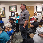 WALDORF, MD - AUG20: Otis Biggs, organizer from the Maryland State Pipe Trades Association, makes public comments in favor of the proposed gas-fired power plant to the Maryland Public Service Commission, August 20, 2015, at the Charles County Public Library in Waldorf, Maryland. The plant would become the fifth plant in a 13-mile radius in southern Maryland and drew a standing room only crowd to comment on the record. (Photo by Evelyn Hockstein/For The Washington Post)