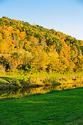 Fall colors burst at Ohio University a long the Hocking River.