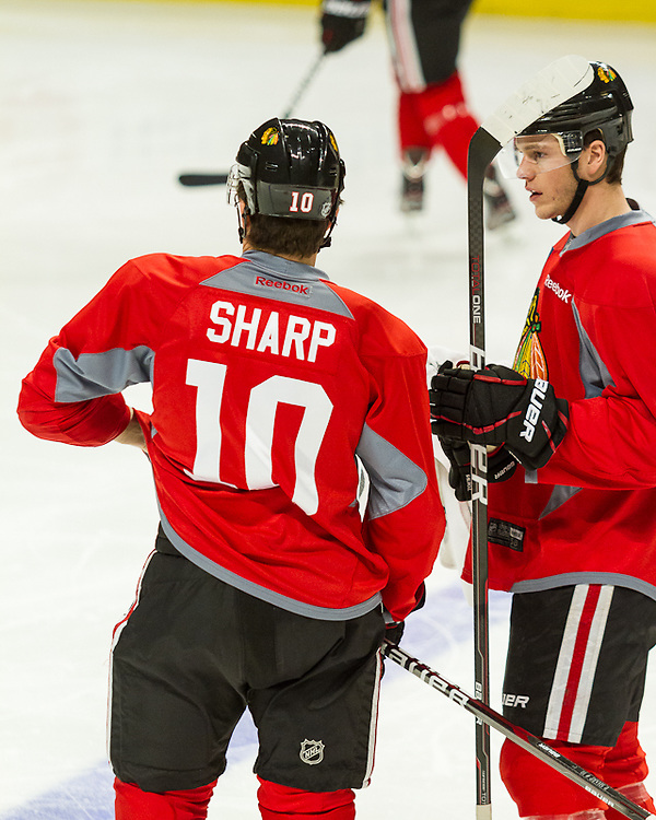 Chicago Blackhawks captain Jonathan Toews and forward Patrick Sharp practicing at the United Center December 29, 2011.