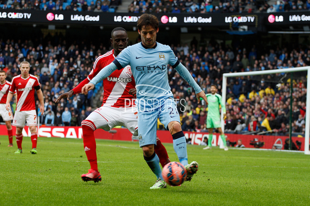 David Silva attacks on the ball during the The FA Cup match between Manchester City and Middlesbrough at the Etihad Stadium, Manchester, England on 24 January 2015. Photo by Richard Greenfield.