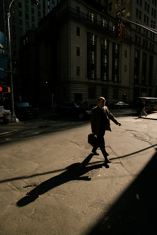 A man walks on the street at downtown Manhattan in New York.