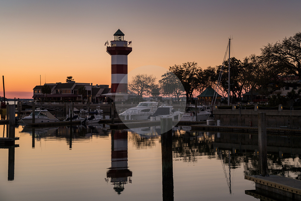 Sunset over Sea Pines Harbor Town lighthouse and marina looking toward Daufuskie Island on Hilton Head Island, South Carolina.