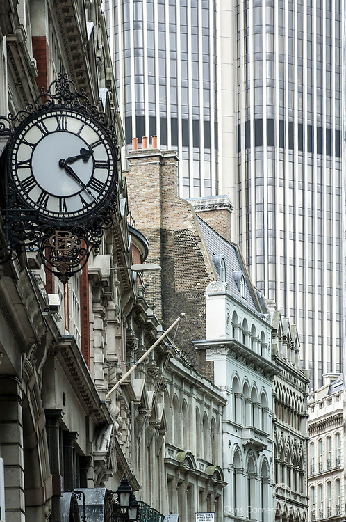 A clock reads 2.22 on the front of a building in the City of London.