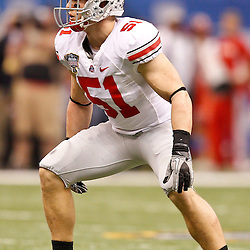 January 4, 2011; New Orleans, LA, USA;  Ohio State Buckeyes linebacker Ross Homan (51) against the Arkansas Razorbacks during the third quarter of the 2011 Sugar Bowl at the Louisiana Superdome.  Mandatory Credit: Derick E. Hingle