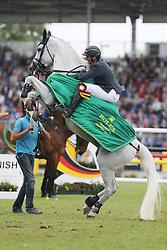 23.07.2017, Aachener Soers, Aachen, GER, CHIO Aachen, im Bild Gewinner, Sieger, 1. Platz: Gregory Wathelet (BEL) auf seinem Pferd Coree, Siegerehrung, Hochsteigen, Jubel // during the CHIO Aachen World Equestrian Festival at the Aachener Soers in Aachen, Germany on 2017/07/23. EXPA Pictures © 2017, PhotoCredit: EXPA/ Eibner-Pressefoto/ Roskaritz<br /> <br /> *****ATTENTION - OUT of GER*****
