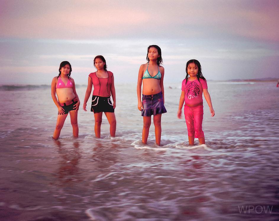 Four summer girlfriends pose on the beach of Mancora, Peru. 2008. (photo by Susana Raab)
