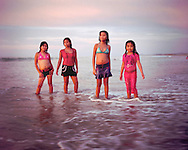 Four summer girlfriends pose on the beach of Mancora, Peru. 2008. (photo by Susana Raab)