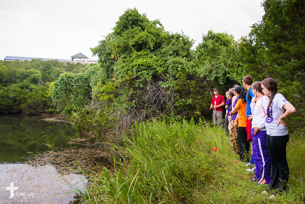 Dr. Sam Whitehead, assistant professor and director of the Environmental Science and Conservation program, leads students on a hike through a part of the 250-acre federally-protected nature preserve at Concordia University Texas on Wednesday, July 16, 2014, in Austin, Texas. LCMS Communications/Erik M. Lunsford