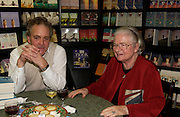 Henry Porter and P.D. James, Hatchards christmas party, Piccadilly, 4 December 2003. © Copyright Photograph by Dafydd Jones 66 Stockwell Park Rd. London SW9 0DA Tel 020 7733 0108 www.dafjones.com