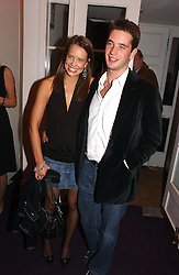MISS ARABELLA MUSGRAVE and the HON.JAMES TOLLEMACHE at a party hosted by jeweller Theo Fennell and Dominique Heriard Dubreuil of Remy Martin fine Champagne Cognac entitles 'Hot Ice' held at 35 Belgrave Square, London, W1 on 26th October 2004.<br />
