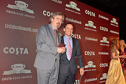 Sebastian Barry, winner of the Costa Book of the Year Award and Dominic Paul, Managing Director of Costa at the Costa Book of The Year Awards held at Quaglino's, 16 Bury Street, London England. 31 January 2017.