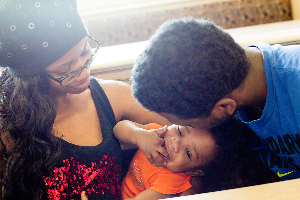 Alexis Lowe hangs out with her 10-month-old son Zayden Lowe and 21-year-old Rashard Bivins, her boyfriend and son's father, on Thursday, May 19, 2016, at IHOP in Grand Rapids. The two met while running track for Ottawa Hills High School. Bivins took care of Zayden during the day while Lowe went to school. She would pick him up after school, cheer or track practice then Bivins would head to work.