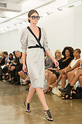 Belted dress in open-weave fabric. By Carmen Marc Valvo at the Spring 2013 Fashion Week show in New York.