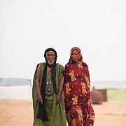 Malian refugees, Alatek Ag Ntalha and his wife Fatimata, in the Mbera refugee camp in southeastern Mauritania. Ntalha says he has been in this newest section of the camp for six days, after a month in a large, makeshift communal tent waiting to be allocated a living space for his family. As of 2 March 2013 there were no latrines and no water points in this section of the camp, necessitating a long journey to an older section of the camp to fetch water. Ntalha says without donkeys there is no way to bring the water back, and that as a result he and his family have been without water for two days.