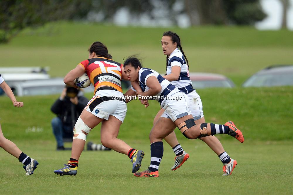 Waikato's Shakira Baker tackled by Auckland Storm's Onjeurlina Leiataua during the Women's Rugby NPC Semi Final, Auckland Storm v Waikato. Auckland, New Zealand on Saturday 10 October 2015. Copyright Photo: Raghavan Venugopal / www.photosport.nz
