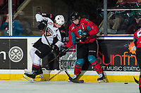 KELOWNA, CANADA - MARCH 16:  Kaedan Korczak #6 of the Kelowna Rockets checks Owen Hardy #15 of the Vancouver Giants during first period on March 16, 2019 at Prospera Place in Kelowna, British Columbia, Canada.  (Photo by Marissa Baecker/Shoot the Breeze)