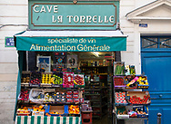 A display of fruit and vegetables outside a green grocer on the Rue De Seine, Paris, France, Europe