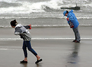 Two women try to walk along the beach through high winds from Hurricane Isabel September 18, 2003 in North Wildwood, New Jersey. Hurricane Isabel brought high winds and heavy surf to the New Jersey coast. (Photo by William Thomas Cain/photodx.com) .
