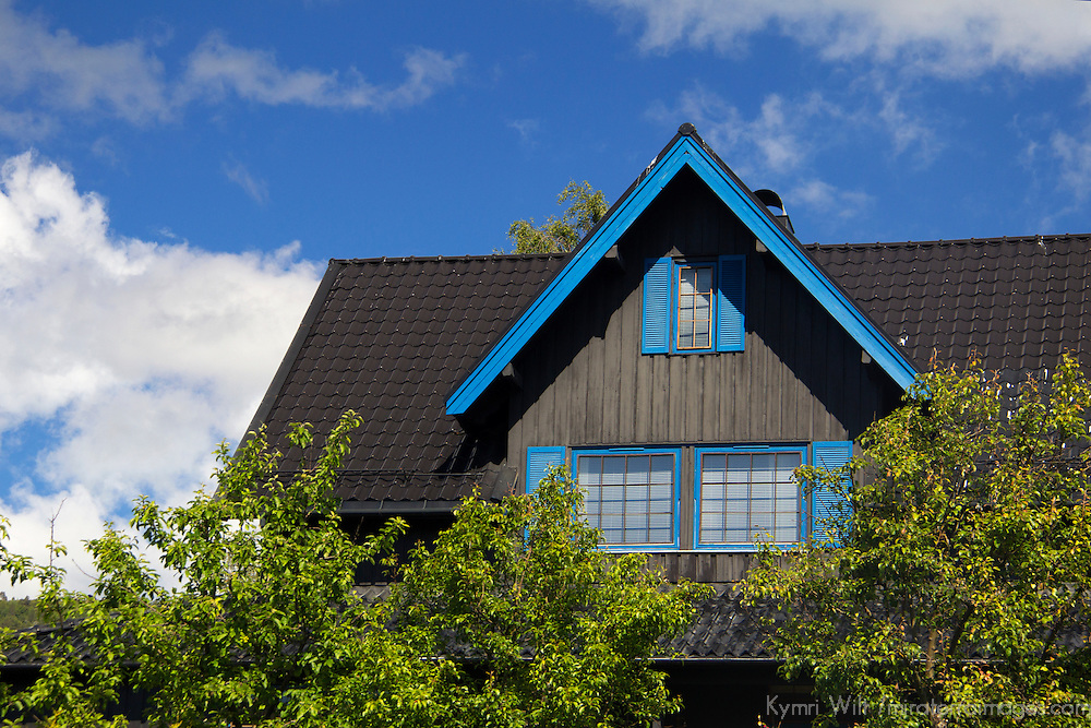 Europe, Norway, Molde. House in Molde, black with blue trim.