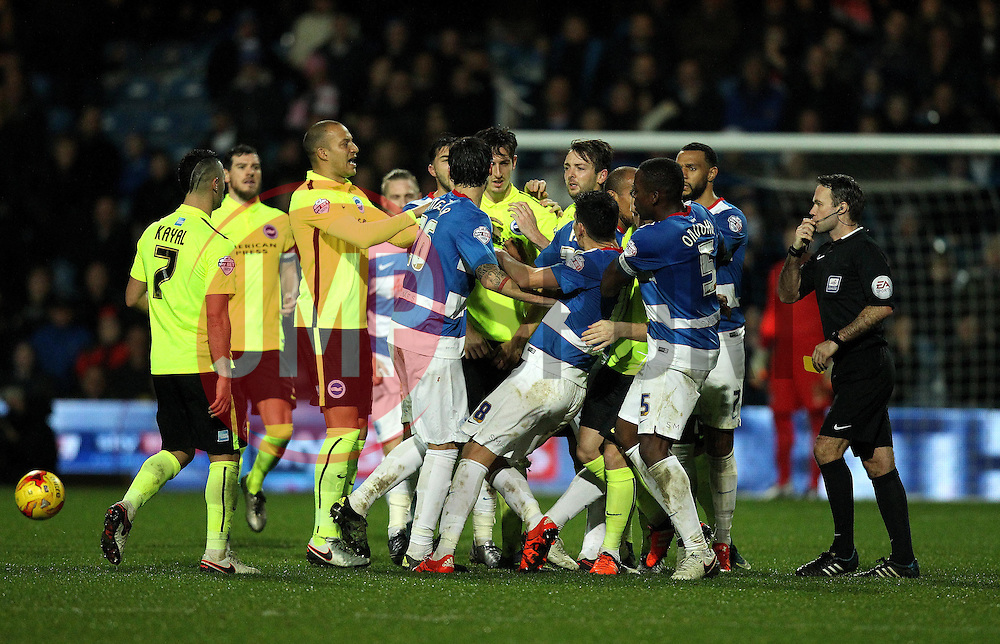 A brawl between the Queens Park Rangers and Brighton & Hove Albion players gets out of control - Mandatory byline: Robbie Stephenson/JMP - 15/12/2015 - Football - Loftus Road - London, England - Queens Park Rangers v Brighton & Hove Albion - Sky Bet Championship