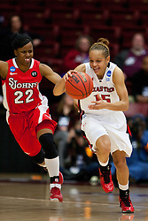 March 19, 2011; Stanford, CA, USA; Texas Tech Lady Raiders guard Casey Morris (15) dribbles past St. John's Red Storm guard Eugeneia McPherson (22) during the second half of the first round of the 2011 NCAA women's basketball tournament at Maples Pavilion. St. John's defeated Texas Tech 55-50.