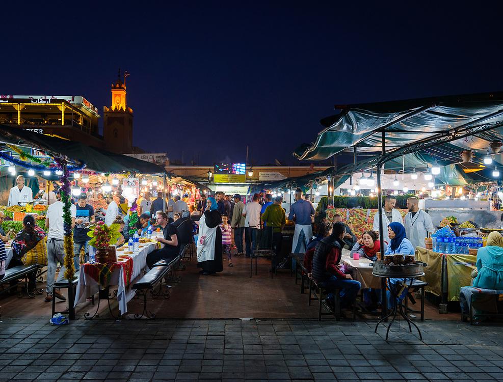 MARRAKESH, MOROCCO - CIRCA APRIL 2018: View of food stalls at the square Jemaa el-Fnaa, at night in Marrakesh